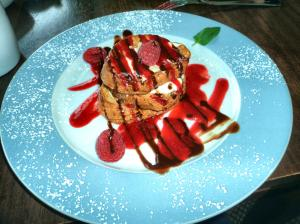 Vanilla french toast drizzled with chocolate and raspberry!
