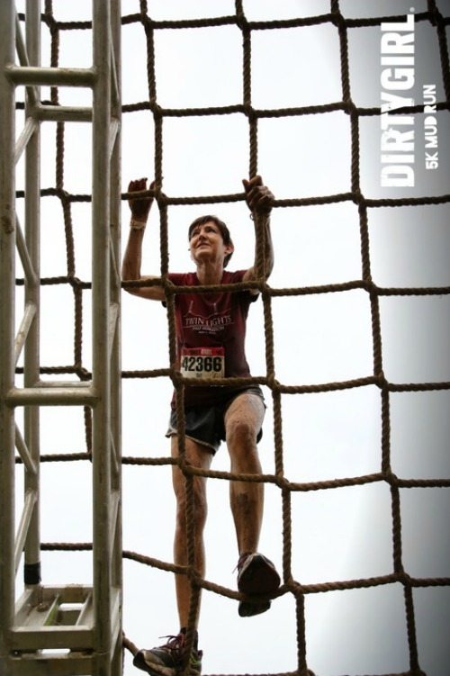 Conquering the ropes net at the Dirty Girl Mud Run!