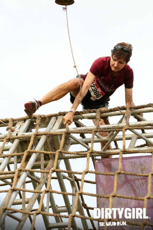 Conquering the ropes obstacle at the Dirty Girl Mud Run
